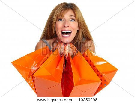 Shopping woman with gifts isolated on white background.