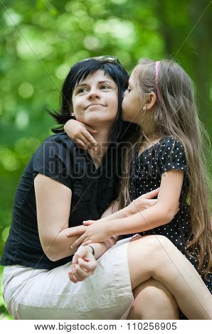Daughter Kissing Her Mom
