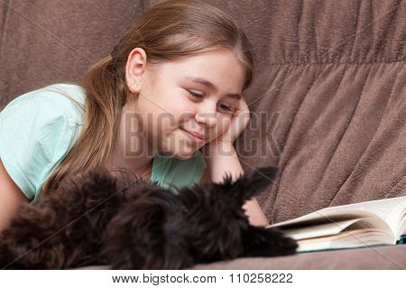Little Girl With A Book And Dog