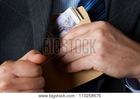 Businessman Putting Envelope Filled With Sterling In Jacket Pock