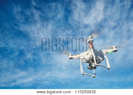 FORT COLLINS CO, USA, DECEMBER 2, 2015:  DJI Phantom 3 quadcopter  drone is flying with a 4K video camera against blue sky.
