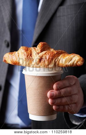 Businessman Holding Takeaway Coffee And Croissant