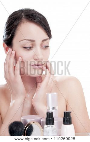 Woman With A Good Complexion Near The Creams Cosmetics. Skin Care Concept.