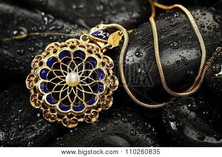 Pendant On Rocks