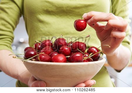 Detail Of Woman Holden Wooden Bowl Of Cherries