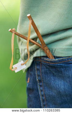 Close Up Of Slingshot In Boy's Pocket