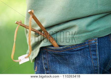 Close Up Of Slingshot In Boy's Trouser Pocket