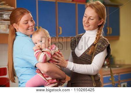 Working Mother Dropping Baby At Nursery