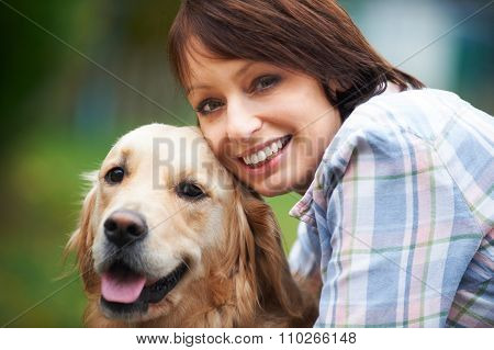 Woman With Pet Golden Retriever