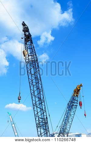 Crane With Hook In Blue Sky Background
