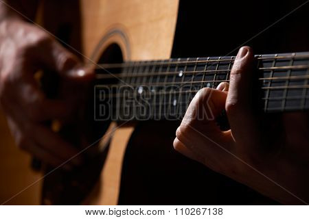 Close Up Of Guitarist Playing Acoustic Guitar