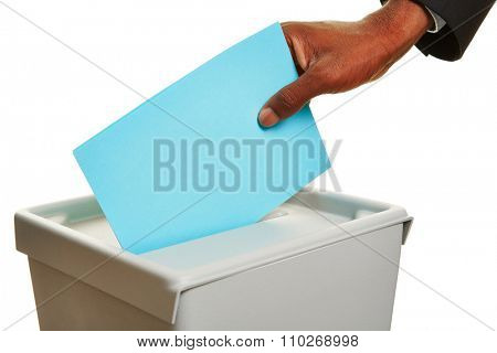African hand with ballot paper at ballot box during an election