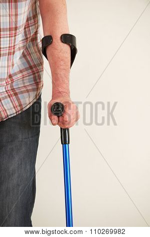 Close Up Of Man Using Crutches