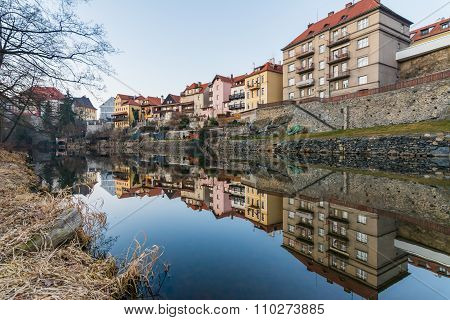 Traditional Colorful Houses In Cesky Krumlov Reflected In The River