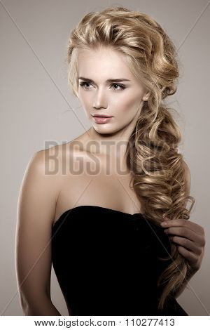 poster of Model with long braided hair. Waves Curls Braid Hairstyle. Hair Salon. Updo. Fashion shiny hair. Wom