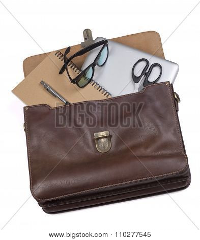 Business briefcase businessman. Brown. Laptop, notebook, scissors, pen.