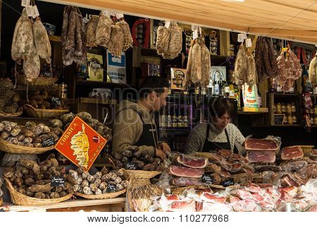 The Unidentified Butchers  At Christmas Market In Paris.