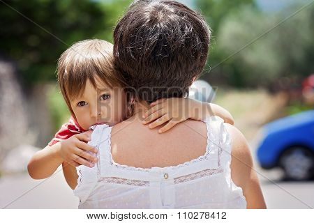 Grandmother, Holding And Hugging Her Grandson, Little Cute Caucasian Boy