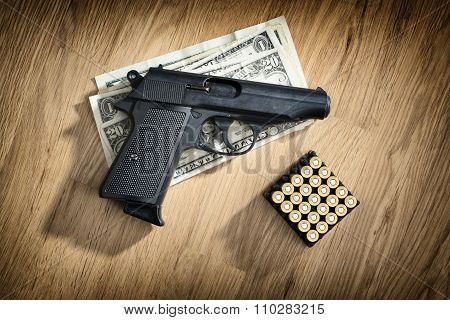 Pistol With Cartridges And Dollar Notes
