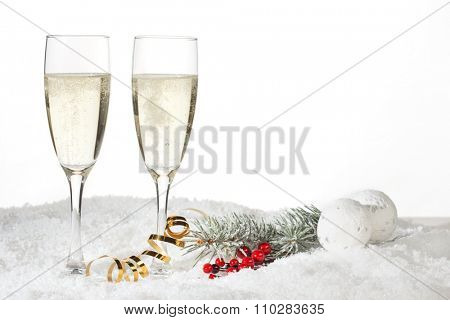 Two glasses of champagne in the snow
