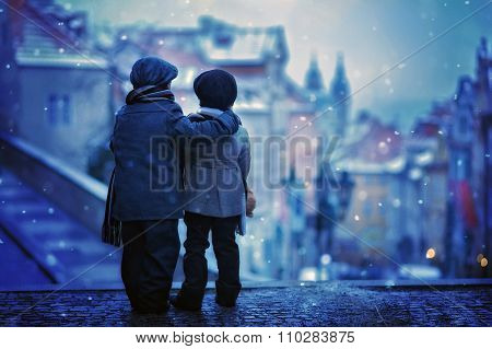 Silhouettes Of Two Kids, Standing On A Stairs, Backwards, View Of Prague