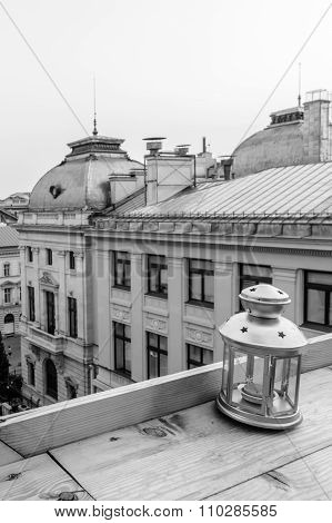 Roof-top View Of A Lantern Over A Small Square. Vertical Black And White View Of A Small Lantern Ove