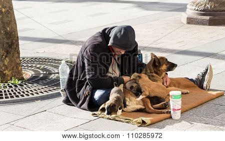The Homeless Is Begging On Champs Elysees Avenus, Paris, France.