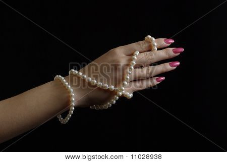 Woman hand with pearl beads