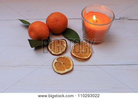 Dried tangerine slices and fresh tangerine on a table