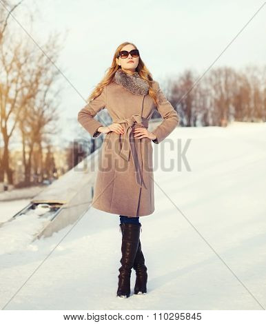 Beautiful Elegant Young Woman Wearing A Coat And Sunglasses In Winter City