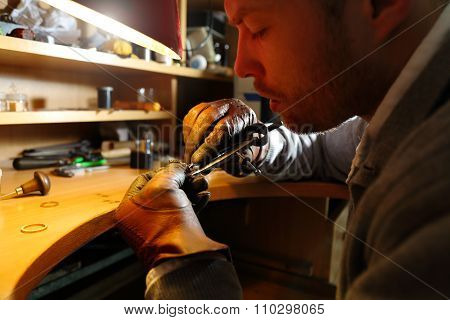 Jeweler measuring a ring with compass divider