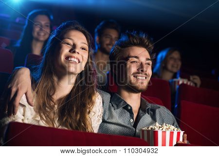 Young Loving Couple At The Cinema