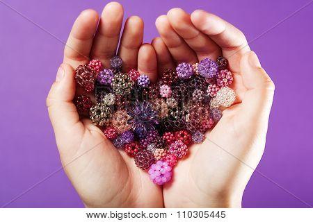 Heart shaped bunch of woven little balls