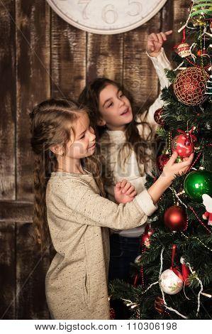 Beautiful Girls Decorating Christmas Tree