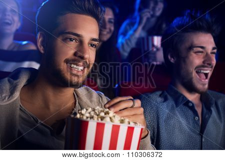 Friends Enjoying In The Movie Theater