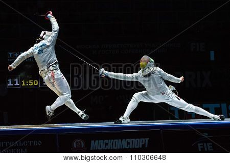 Two athletes fencing at tournament