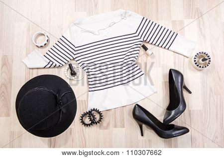 Striped Blouse With Accessories Arranged On The Floor.