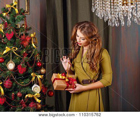 Girl Is Preparing Gift. Christmas Tree.