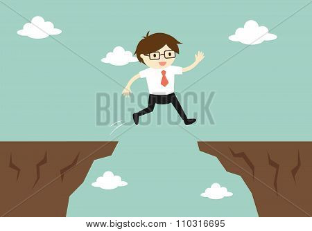 Business concept, businessman jump through the gap to another cliff.