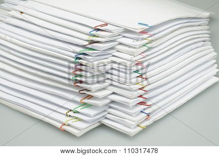 Colorful Paper Clip With Pile Of Paper Reports Arranged On Table