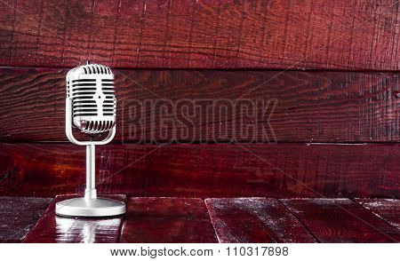 Retro microphone on wooden table