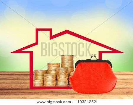 Many Coins In Column In House And Red Purse On Wooden Table Over Nature