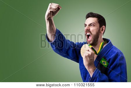 Brazilian judoka fighter holding a medal on green background