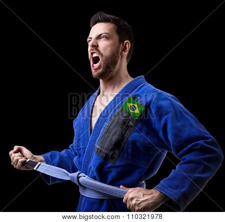Brazilian judoka fighter isolated on black background
