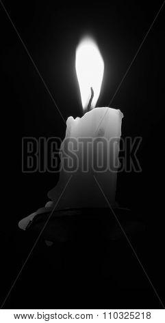 Burning Candle On Candlestick Isolated On Black Background Black And White