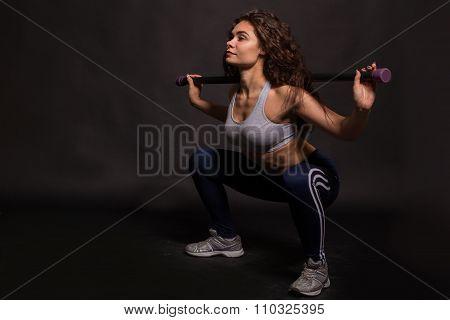 Beautiful athlete fitness stamp. Squats and training racks.