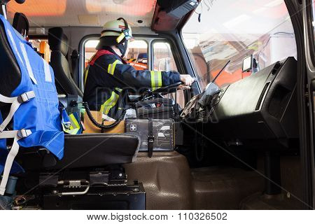 Firefighter in action and drives a fire truck