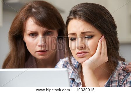 Mother Comforting Daughter Victimized By Online Bullying