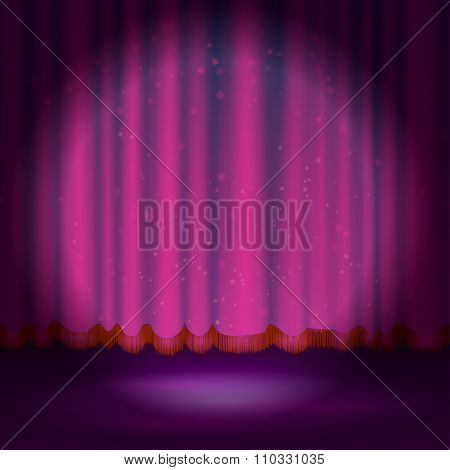 Spotlight on magenta stage curtain