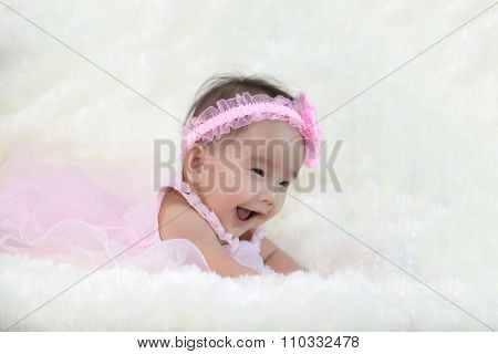 Cute Five Months Asian Baby Laughing With Pink Dress., On Bright Soft Carpet.